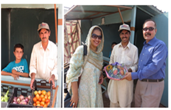 Mr.Ibrar Hussian presenting his produced vegetable as a souvenir to USAID Team from his outlet.